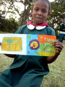 Christina, from Class 3B, shows the card she made for her mom and dad
