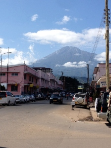 view of Mt. Meru from a street in Arusha